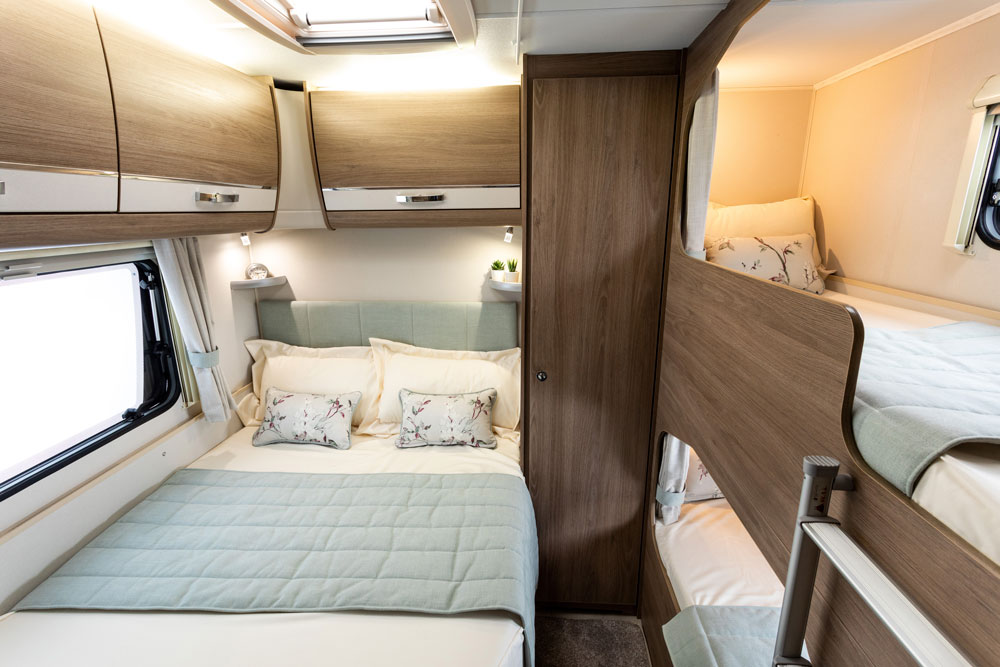 The double bed and bunks in the bedroom of the Compass Casita 868 caravan
