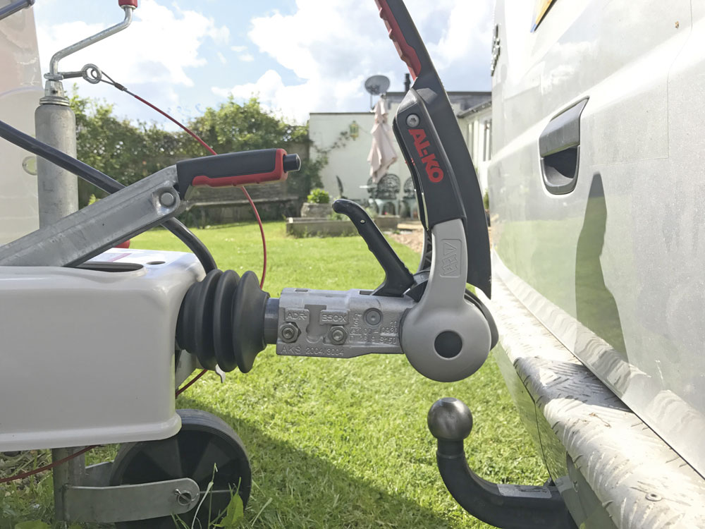 A tow bar and hitch ball for a caravan