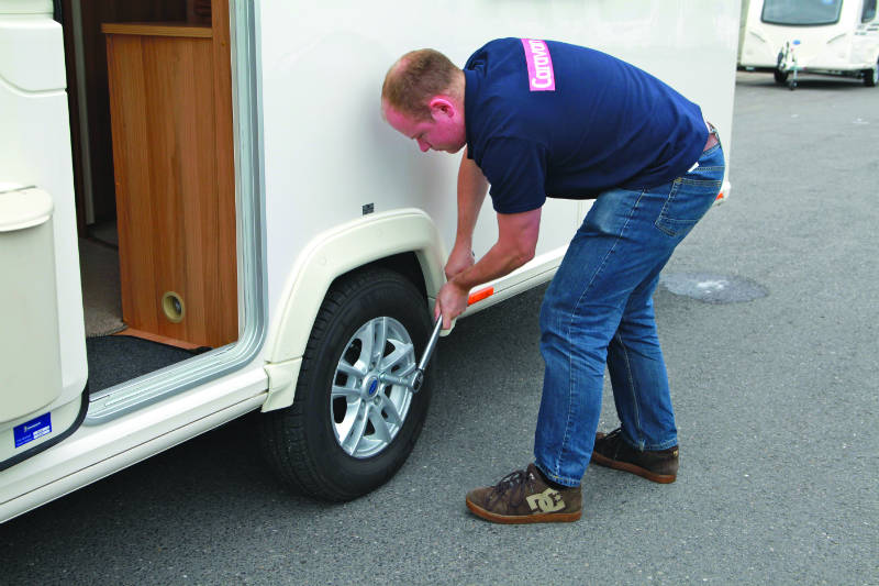 Adjusting the wheel nuts on a caravan