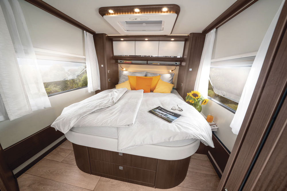 The interior of a Morelo Loft motorhome, showing a double bed