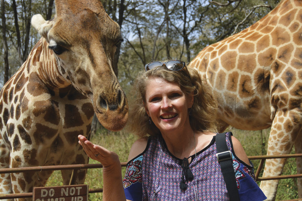 Travel writer Tracy Brooks with giraffes at Kruger National Park
