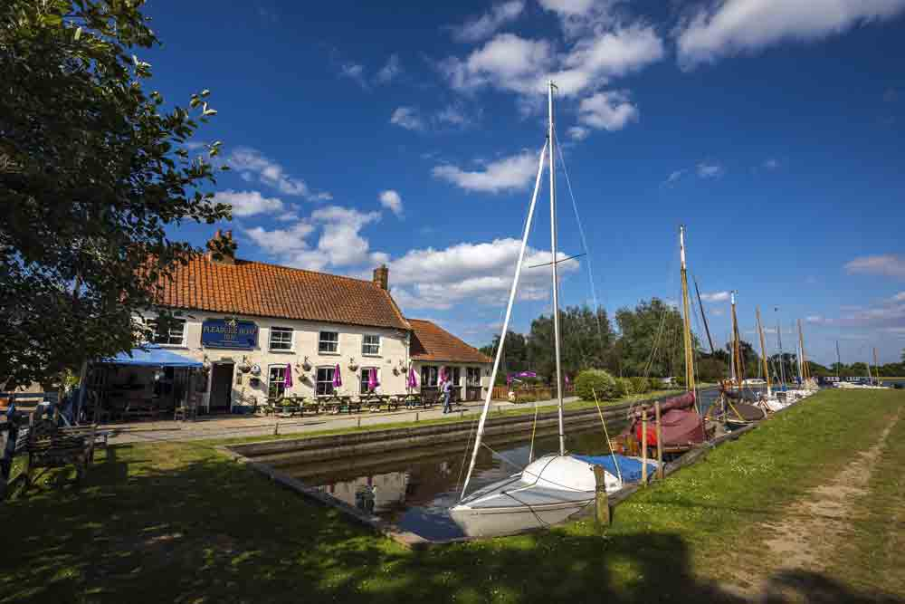 Image of a pub beside a river in the Norfolk Broads