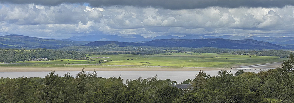 Mountains of the Lake District are visible from Arnside Knott
